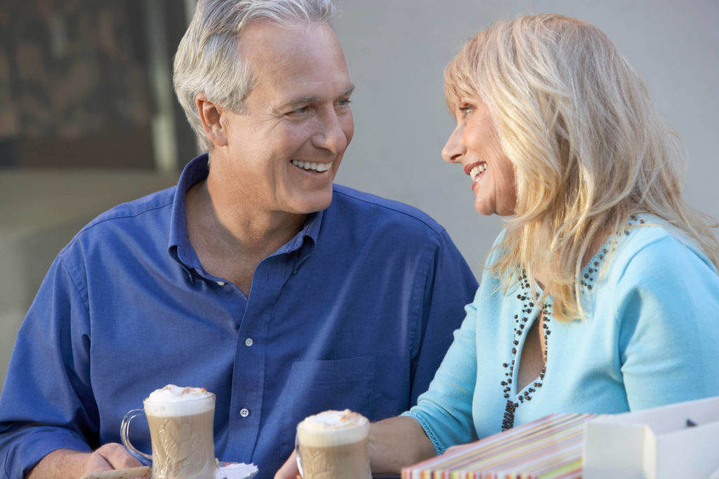 Couple over 60 having coffee drinks